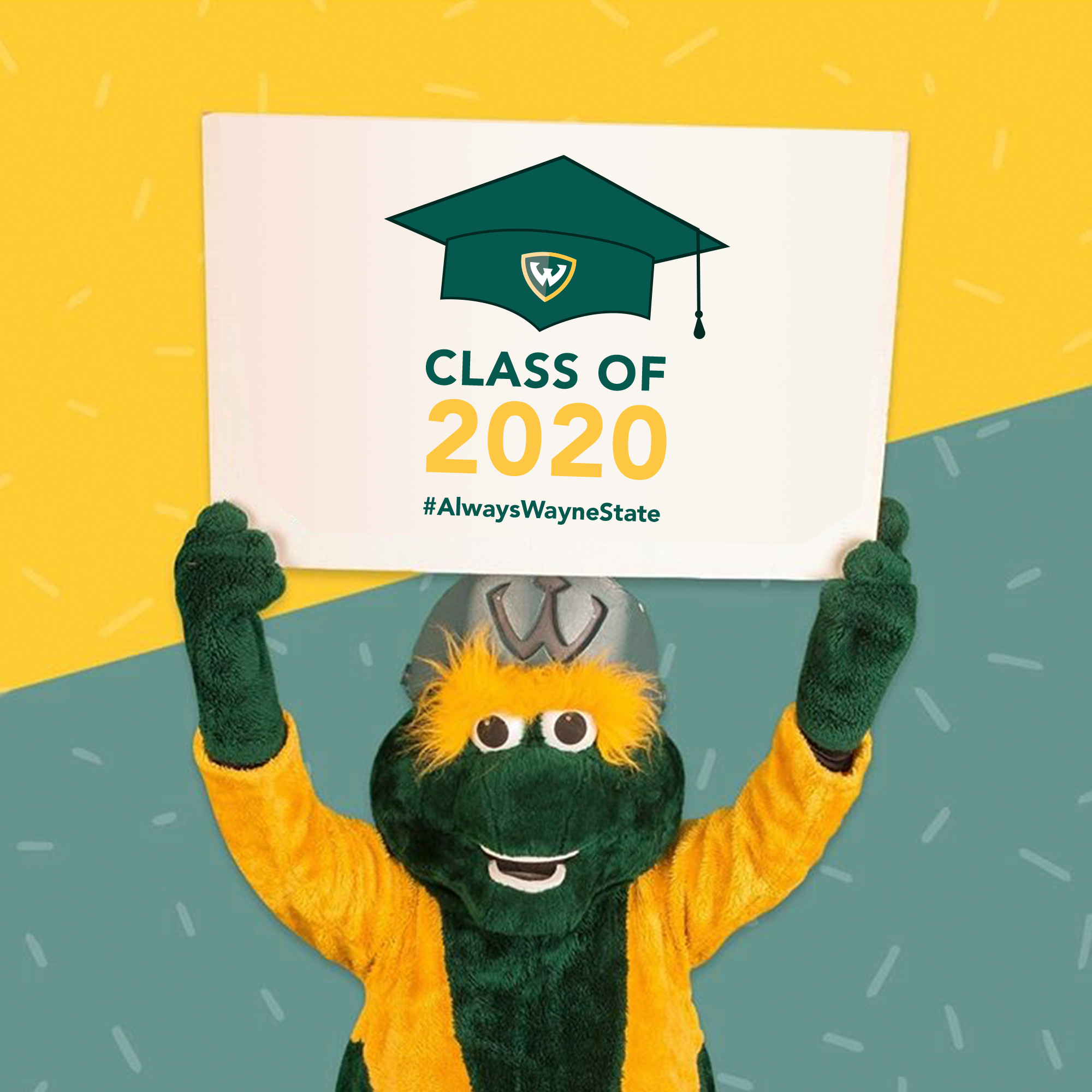 Mascot W holding Class of 2020 sign